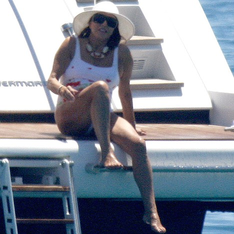 joan collins enjoying a luxury yacht