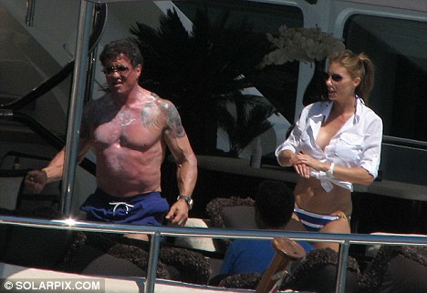 Stallone can be seen below, complete with tattoos, enjoying a spot of