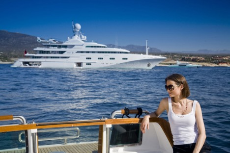 A very large luxury motor yacht in the background.  See below for stories and pictures of famous celebrities on yachts.