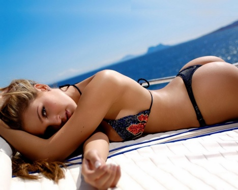 Bikini Girl sunbathing on a yacht